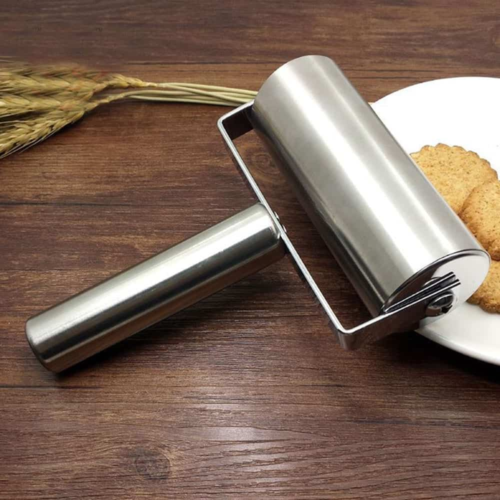 A plate with a fork and knife sitting on top of a wooden table